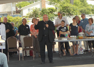 Bishop Morlino speaking at Women's Care Center open house