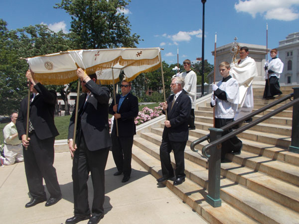 Preparing to head back down the Capitol Steps, bringing the Blessed Sacrament under the canopy. This is Deacon Garrett Kau with the monstrance.