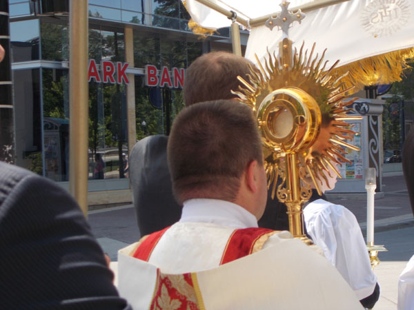 2012 Madison Corpus Christi Procession: Deacon Vince Brewer carries the Monstrance with Jesus from St Patrick's Church, toward Capitol Square.