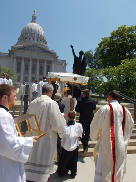"2012 Madison Corpus Christi Procession ascends the steps, past the ""Miss Forward"" statue."