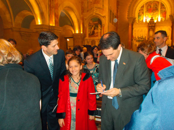 Governor Scott Walker signs an autograph for Paul Ryan's little girl Liza