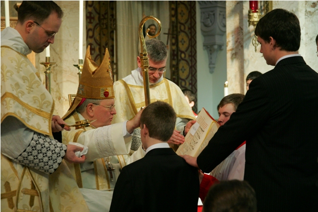 Bishop Ricken of Green Bay Confirms a young man according to the traditional rite (extraordinary form)