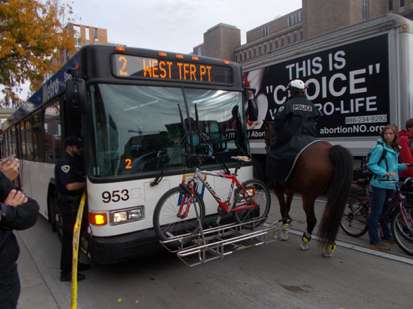 Police horse and bus.