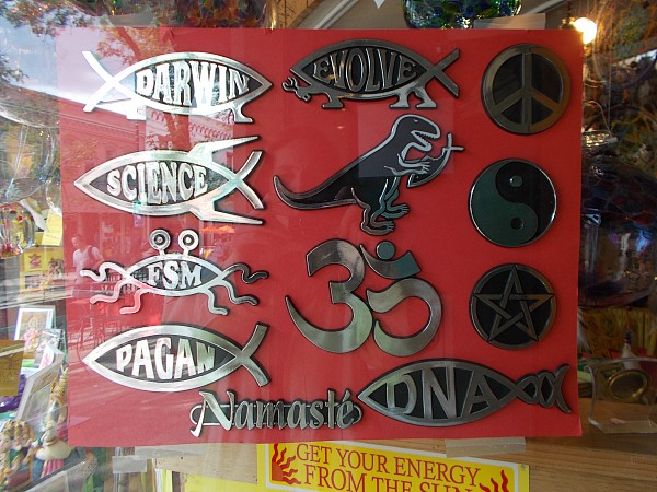 Impious car emblems for sale in a shop window on State Street