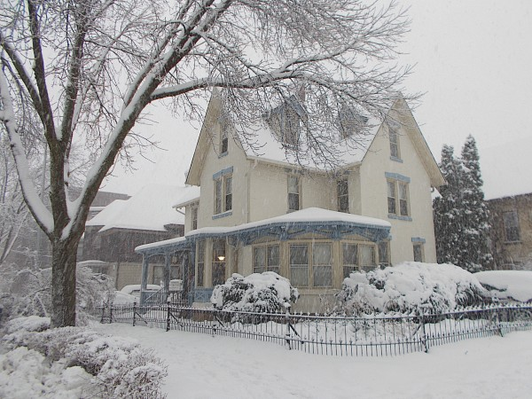 Pretty house at W Gilman and Henry Street in the snow