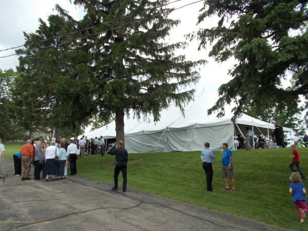Fr Rick 25th anniv party tent msgr Bartylla center