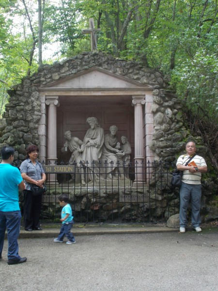 The whole group went first to pray the Stations of the Cross. The sculptures for the 14 stations showing the suffering and death of Jesus for our salvation are carved from limestone and placed on a path that winds up the hill. Here Padre Jose Luis (on the right) is about to begin leading the prayers.
