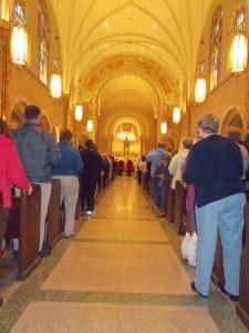 Cardinal Dolan incensing the altar