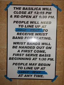 Event sign posted inside the Basilica narthex