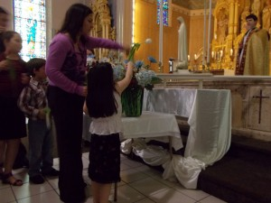 Presenting flowers to Mary