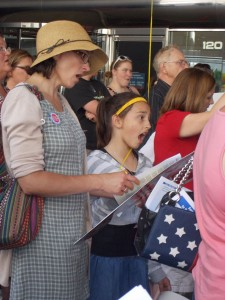 Mother and Daughter singing at June 8th Stand Up for Religious Freedom Rally in Madison