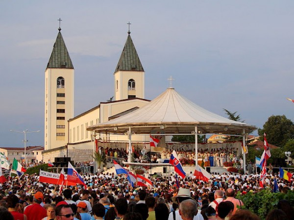 """Medjugorje festival: the parish church of St James, and the pavilion where the """"seers"""" have their """"visions"""" because the bishop forbids them from doing so in the church"""