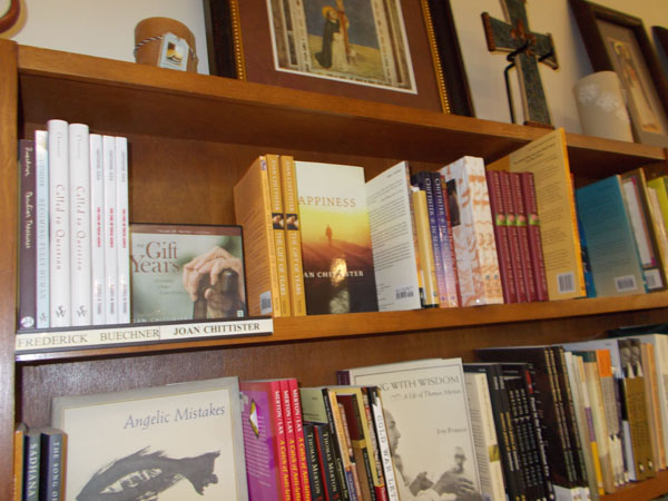 At Sinsinawa Mound Gift shop, a whole shelf of Joan Chittister's books, with a shelf or two of Thomas Merton below.