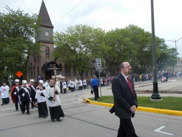 """Tim Virnig of the Knights of Divine Mercy, the man in the lead, says on facebook: """"The reason I look so serious is that it was taken immediately after the police officer was confused and thought we didn't have the correct permit. I was praying fervently that they wouldn't stop us."""""""