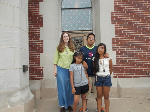 Here are the kids and myself, with our scapulars in front of the Saint John of the Cross bronze doors of the upper Basilica Church. I was clothed with the scapular by the Carmelites some years ago and wear it always with strong devotion to Carmelite spirituality and the love of Our Lady. We had a great day of spiritual learning and growing and climbing! Maria del Carmen, Mamacita, continue to be a help to us!