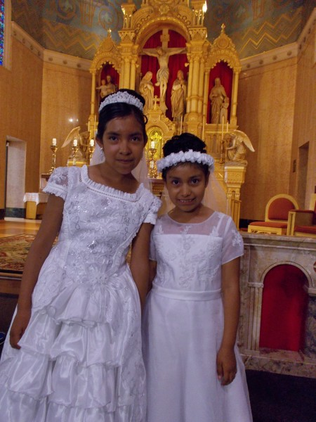 Brand new Christians! Isabel and Leslie after their baptism at Holy Redeemer Church in June.