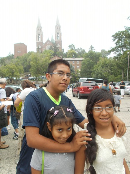 We've arrived! Jose, Leslie and Isabel with the amazing basilica church in the background.